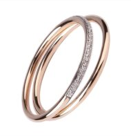 Zestaw dwóch pierścionków typu ring z różowego złota z brylantami